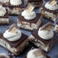 Peanut Butter Snickers Cheesecake Bars
